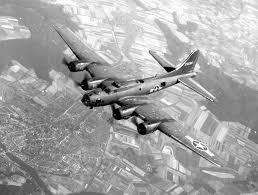 b 17 flying fortress history and specs of boeing s ww2 bomber b 17s join group b 17 flying over town and farmland