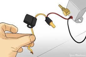 9 how to install offroad lights on your vehicle person holding an inline fuse holder blade fuse in it jpg how to install offroad lights on your vehicle yourmechanic advice 1000 x 667