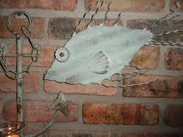 rustic turquoise metal fish wall decor