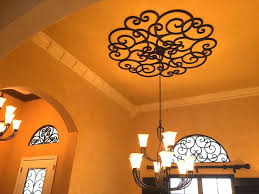 faux wrought iron window inserts faux iron ceiling medallion accented by faux iron transom window inserts faux wrought
