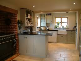 shaker style kitchen with slate worktops ceramic flooring