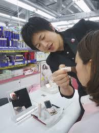 kyodo makeup men kei kishimoto applies makeup to a customer at a in the city