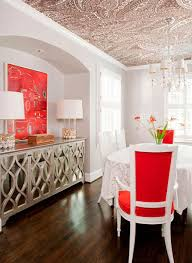 dining room with red furniture and textured wallpaper on ceiling