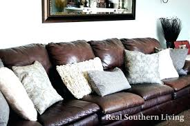 brown leather couch with red pillows throw accent for sofa throws best decorating bedrooms astounding
