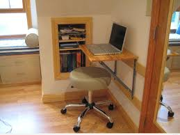 small and easy diy wood wall mounted folding computer desk design with light green leather stool with stainless steel legs on wheels beside wall bookshelf