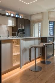 lighting solutions for dark rooms. soft strip shines along the bottom of these kitchen cabinets for a serene effect unique led lighting solutionsmodern lightingoutdoor solutions dark rooms