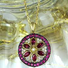 18k yellow gold ruby and diamond flower pendant add to cart rubyflowerpendant2
