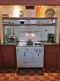red vintage chambers stove model 90c highback set in vintage kitchen with subway tiles and cork