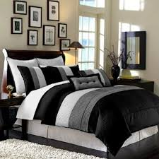 bedroom striped black white and grey comforter sets on grey bed having tall headboard and