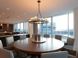 modern dining room design with extendable round wooden dining table light grey leather arm dining