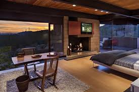 modern master bedroom with fireplace. Modern Master Bedroom With Stone Fireplace, Hardwood Floors, High Ceiling Fireplace