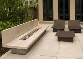 gas fireplace outdoor with modern wicker furniture set