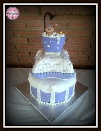 two tier lavender and white baby shower cake with one tier being a pillow cake includes custom baby in the bathtub topper