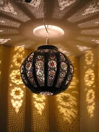 large pierced globe lamp with coloured glass