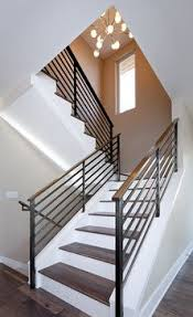 Wood Handrail and Wrought Iron Stair Railing