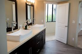 beige granite bathroom countertop with white porcelain rectangle his and hers sinks