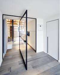 glass and aluminium pivot door with central axis
