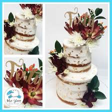 Tiered Naked Wedding Cake With Fall Blooms Blue Sheep Bake Shop
