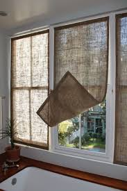 last week i made some new burlap window coverings for the master bathroom i made