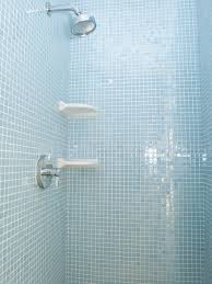 gorgeous light blue shimmering mosaic glass tile gives this shower the feeling of a spa