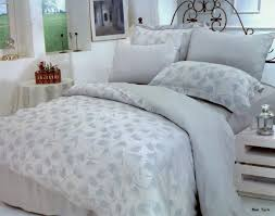 this magnificent duvet bedding set has a light silver blue backdrop with alice