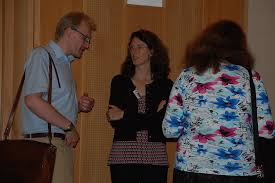 Anne chats with Michael (?), a cultural anthropologist.   Flickr
