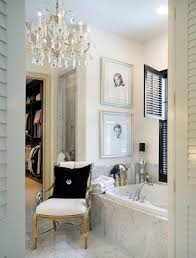 bathroom chandelier lighting ideas. marble bathroom with tiles floor glossy black shutters and crystal chandelier lighting ideas