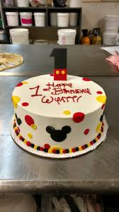 A Festive First Birthday Cake Featuring A Mickey Mouse Fondant One
