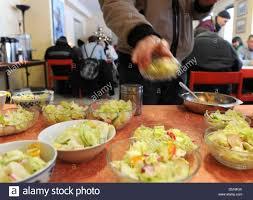 Soup Kitchen Meal A Homeless Person Is Served A Warm Meal And Salad At The Soup
