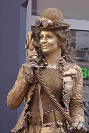 the term living statue refers to a street artist who poses like or mannequin usually with