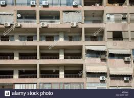 air conditioning units for apartments. close up of apartment block balconies with washing and air conditioning units. egypt. units for apartments c