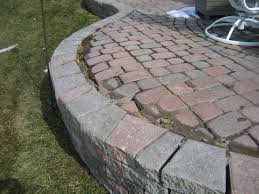failure of raised paver patio wall steps due to inexperienced landscaper