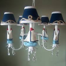 white blue navy kid bedroom chandelier design idea boat theme clear glass acrylic decor gray painted accent wall stained metal chain fabric shades baby