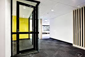 modern office door. Modern Office Or Apartment Area Through The Hallway With Glass Doors Opened And Lights On Stock Door