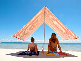 a simple stylish solution for staying cool on the beach