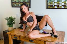 Nikki Benz in black high heels strips and poses in the office.