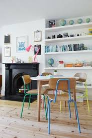 bright chairs and colourful shelves for a fun living room