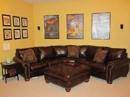living room ideas with brown sectionals. Comfy Brown Sectional With Ottoman Yellow Wall Color Elegant Coffee Table For Bright Living Room Ideas Using Leather Sofa Sectionals