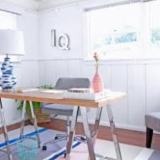 stylish home office with modern desk and striped rug blue modern home office