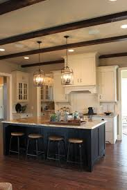 over stove lighting. great hood over stove and with deep to the ceiling cabinets subway lighting k