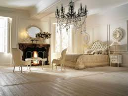 decorating with vintage furniture. modern bedroom with fireplace vintage furniture and large chandelier in style decorating