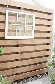 how to build a diy privacy wall to polish off your outdoor space