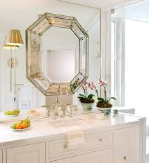 my favorite trend now is mounting your light fixture onto a huge mirror in the bathroom mirrors make small es appear larger than what they are and