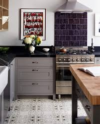 a dark soapstone countertop provides a lovely contrast to grey cabinets in this kitchen by red design studio image credit red design studio