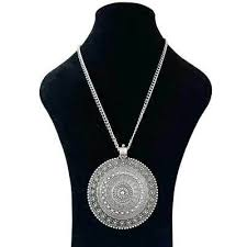large silver abstract metal boho round