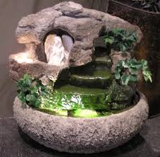 angel fountain w artificial foliage