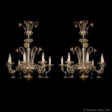 a fine pair of venetian clear glass eight light chandeliers