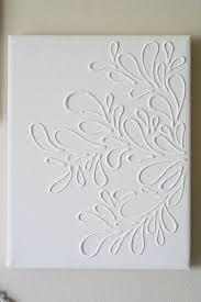 3 white puffy designs