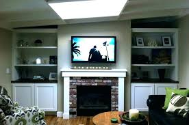 mount tv on brick fireplace hide wires mounting a over a fireplace into brick hang on brick wall wall mount fireplace mount above fireplace installing wall