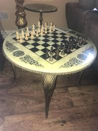 vintage round with wooden chess pieces table set